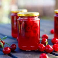 Tart cherry jam in small clear jars