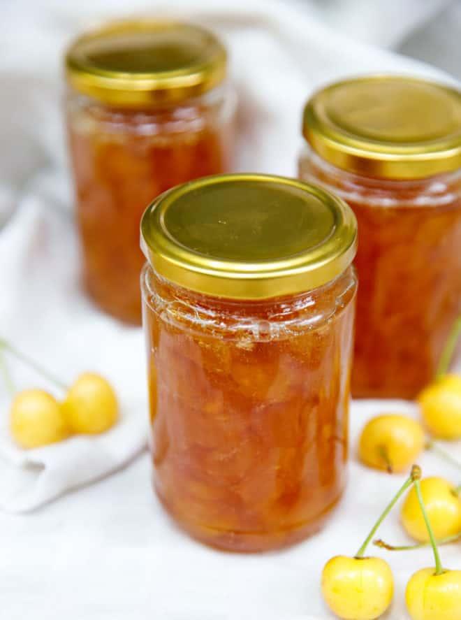 White cherry jam in clear 12 oz jars