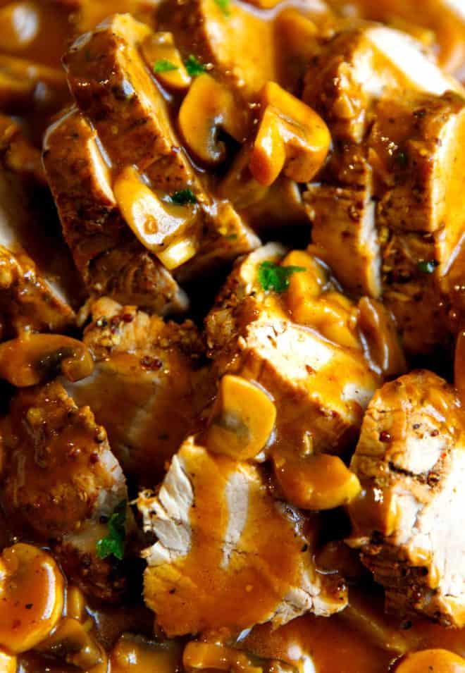 Pork tenderloin sliced and topped with mushroom gravy