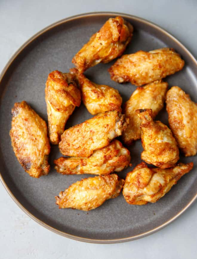 Air fryer chicken wings on a gray plate