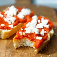 Lutenitsa on a slice of bread with feta on top