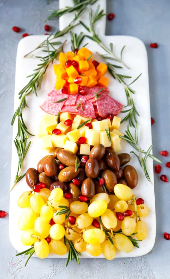 A marble board with Christmas tree cheese tray appetizer