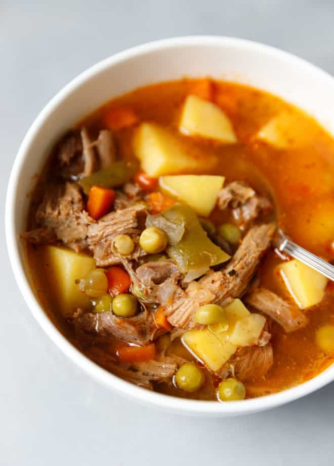 Beef and vegetable soup in a white bowl