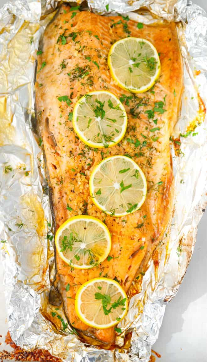 Baked trout on foil with lemon slices