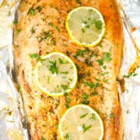 A fillet of steelhead trout on foil