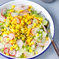 Iceberg corn and radishes in a bowl
