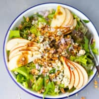 Apple walnut salad in a white bowl