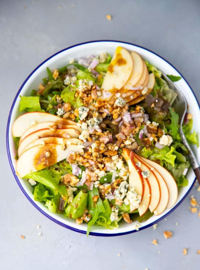 Apple walnut salad in a white bowl
