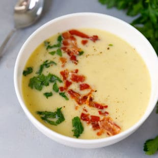Leek potato soup in a white bowl