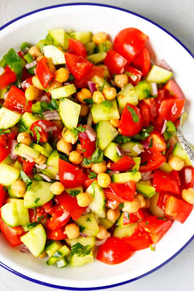A white bowl with the best chickpea salad