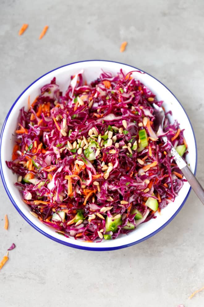 A bowl filled with red cabbage salad