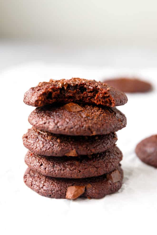 Vegan almond flour chocolate cookies stacked on top of each other