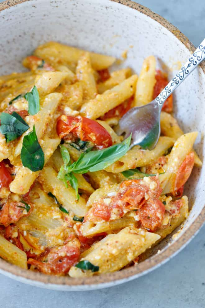 Baked feta pasta in a bowl with fork
