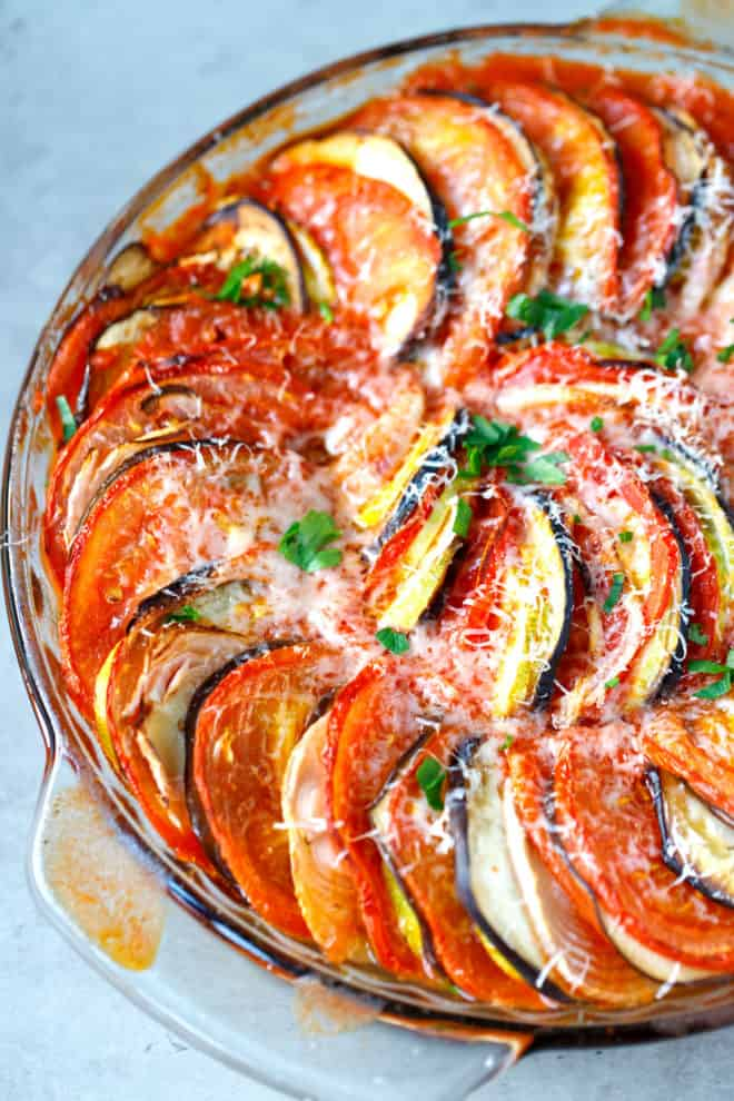 Baked layered ratatouille in a round dish