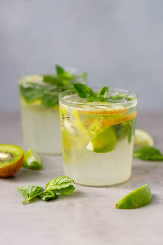 Two clear glassed with kiwi mojito