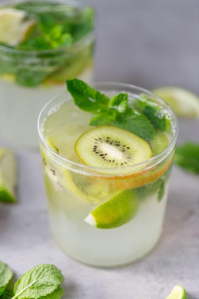 a glass with kiwi mojitos